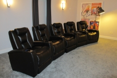 Media room with a curved set of 5 Fusion Collection Escape-1019 recliners