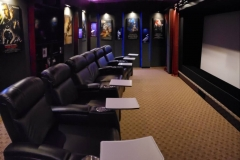 An amazing home theater with a row of 6 Fusion Collection Jive-1013 motorized recliners with aluminum trays, stainless steel cup holders, USB ports and Buttkicker ready feature